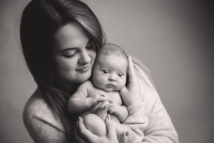 Baby Photographer Glasgow - Mum holding baby girl