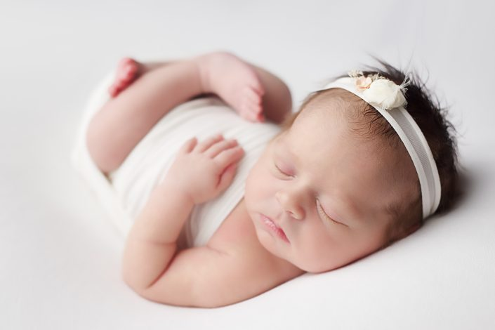 Newborn Photo Shoot Glasgow - baby on white backdrop