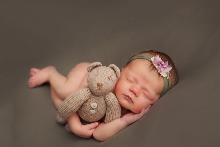 Baby Photographer Glasgow - baby girl cuddling teddy