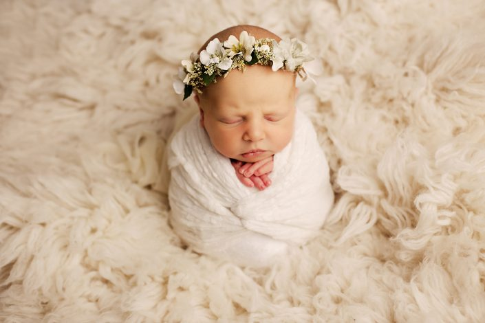 Newborn Photographer Glasgow - baby girl on cream flokati