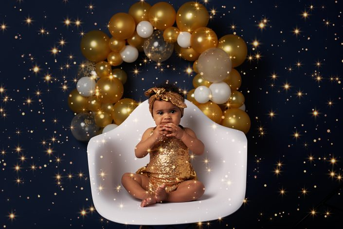 Family Photographer Renfrewshire - baby girl in gold romper