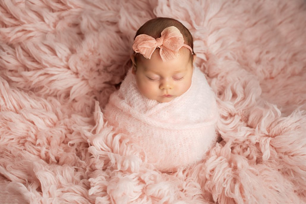 wrapped baby with pink bow, newborn mini session glasgow